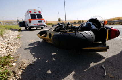 Motorcycle laying over after an accident